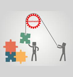 teamwork concept - an employee raises a puzzles vector image