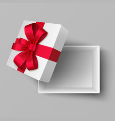 empty open box with red silk ribbon and gift bow vector image