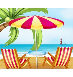 A chair and an umbrella at the beach vector image