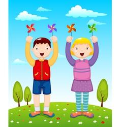 Kids playing wind wheel vector image vector image