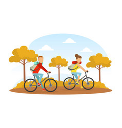 couple riding bikes in autumn park outdoor vector image