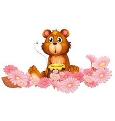 A garden of pink flowers with a bear vector image vector image