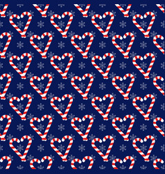 Christmas seamless pattern with candy canes vector