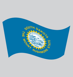 Flag of south dakota waving on gray background vector