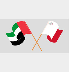 Crossed and waving flags malta and united arab vector