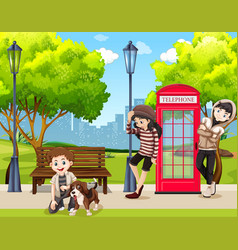 Teenagers and dog in park vector