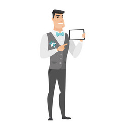 Smiling groom holding tablet computer vector