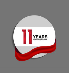 11 years anniversary design in circle red ribbon vector