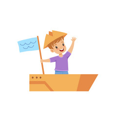 little boy playing sailor with boat made of vector image