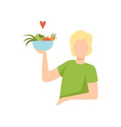 young man holding a bowl of vegetables healthy vector image