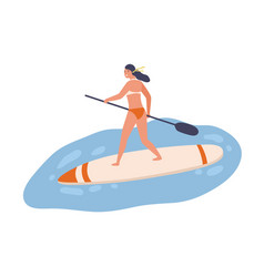 Young fit woman standing on sup board with paddle vector