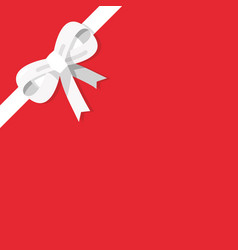 white bow isolated on red background vector image