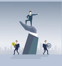 business man standing on big businessman hand vector image