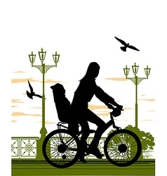 Woman and baby on bike vector