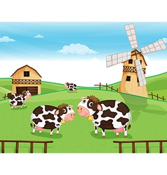 Goats at the farm with a windmill vector