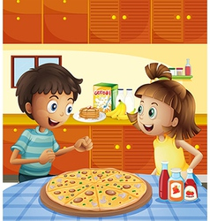 Kids at the kitchen with a whole pizza at the vector image