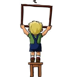 Boy hangs a picture vector