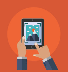 holding tablet and taking a picture or video vector image
