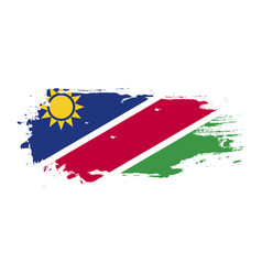 Grunge brush stroke with namibia national flag vector