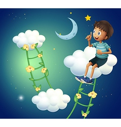A boy sitting at the cloud vector image