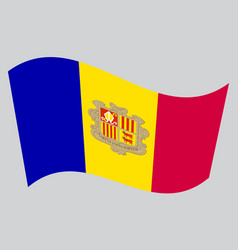 Flag of andorra waving on gray background vector