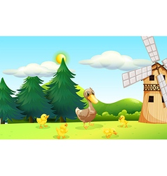 A duck and her ducklings near the wooden farmhouse vector image