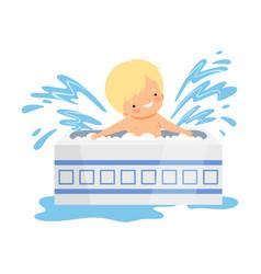 Cute little boy bathing and having fun in bathtub vector