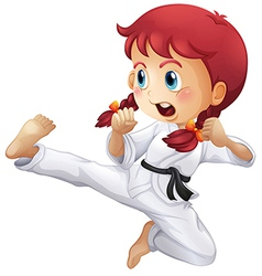 An energetic little girl doing karate vector