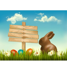 Chocolate bunny with easter eggs and a sign in a vector image