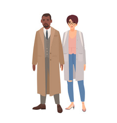 Smiling man and woman dressed in coats standing vector