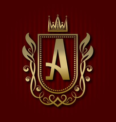 Golden royal coat of arms with a monogram vector