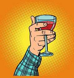 hand with a glass of red wine vector image