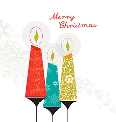 Three colorful Christmas candles with ornaments vector image