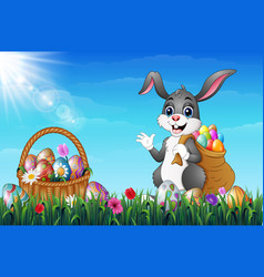 easter bunny carrying sack full of easter eggs in vector image