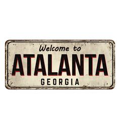 welcome to atalanta vintage rusty metal sign vector image