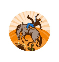 Cowboy falling off horse in the desert vector