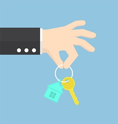 Hand holding a house key vector