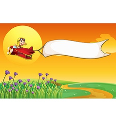 An airship with a monkey and a white banner vector image vector image
