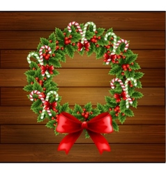 Christmas holly wreath in wood background vector image