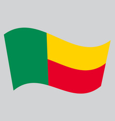Flag of benin waving on gray background vector