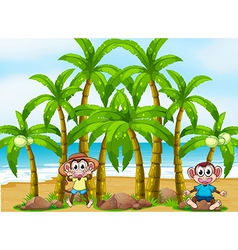 A beach with coconut trees and playful monkeys vector