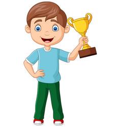 cartoon little boy holding gold trophy vector image