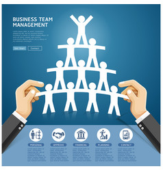 hand holding a paper cut people team vector image