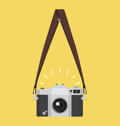 Hanging old camera in a flat style with strap vector