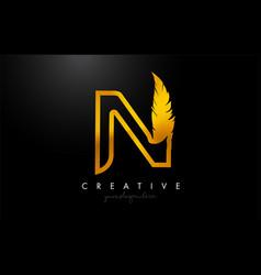 N golden gold feather letter logo icon design vector