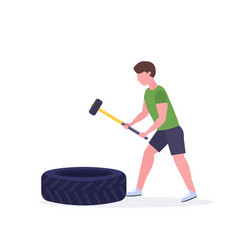 Sports man hitting big tire with hummer doing hard vector