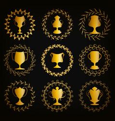 Golden shields with laurel wreaths cups vector