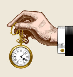 hand of man with a gold retro pocket watch vector image