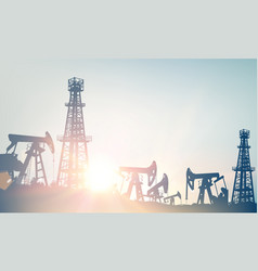 Oil field with derricks and pumpd over blue sky vector