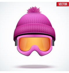 Knitted woolen pink cap with snow goggles winter vector